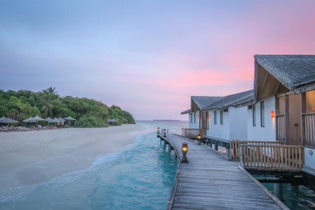Malediven Inseln Reethi Beach Wasserbungalow Sonnenuntergang