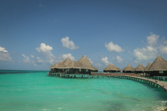 Malediven Reise Coco Palm Dhuni Wasservillen