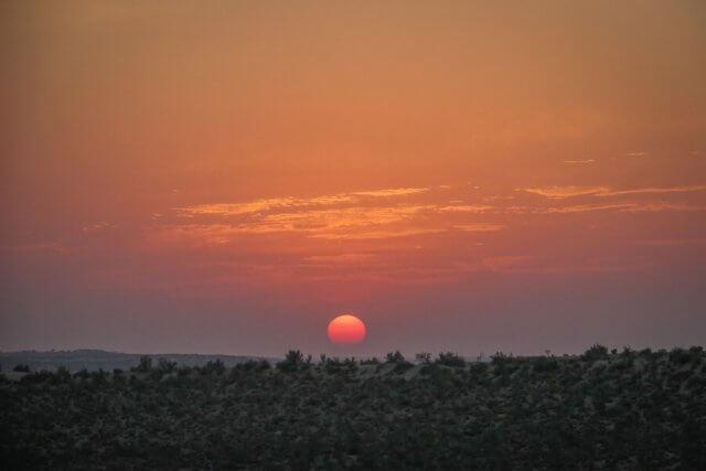 Rajasthan Rundreise Jaisalmer Kamelsafari Camp Sonnenuntergang